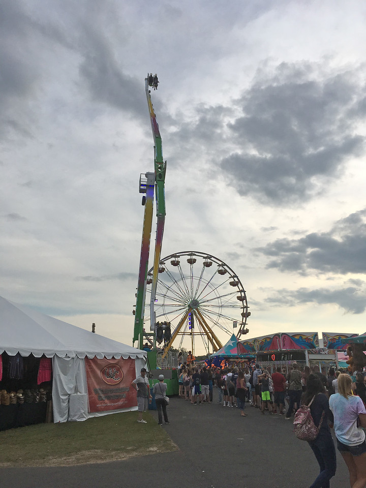 Karen Alvord - Oneida Daily Dispatch Fair goers enjoy the Great New York State Fair in Geddes on Monday, Aug. 28, 2017.