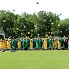 Stacey Diamond | The Goshen News<br /> Members of the class of 2017 at Northridge High School toss their caps in the air at the conclusion of commencement ceremonies Sunday.