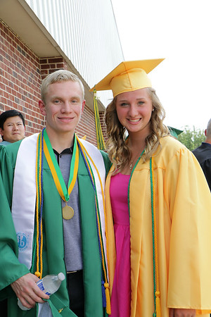 Stacey Diamond | The Goshen News<br /> Camden Koch and, Rylee Dahlman share a moment before their graduation at Northridge High School. In the background is teacher Zhongjie Liang.