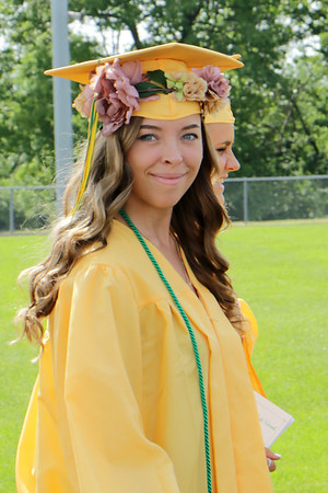 Stacey Diamond | The Goshen News<br /> Rachel Amis of Middlebury placed flowers around her graduation cap during the Northridge High School graduation ceremony.