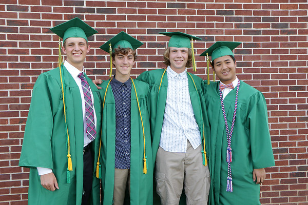 Stacey Diamond | The Goshen News<br /> Spencer Lehman, Blake Mawhorter, Nick Kiepe and Arunrat Lapsongsakul, a foreign exchange student from Bangkok, Thailand, gather together before the Northridge High School graduation ceremony.