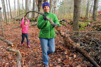 IMG_6346 Zella Little,6, and her mom Heather,,carry a log to be used as part of the latrine