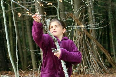 IMG_6370 sadie boulbol,9, cutting a sapling blocking the trail