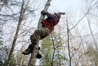 IMG_6312 Justin Park shinnies up a tree to untie an old rope holding up a tarp, that was being replaced with a lean-to
