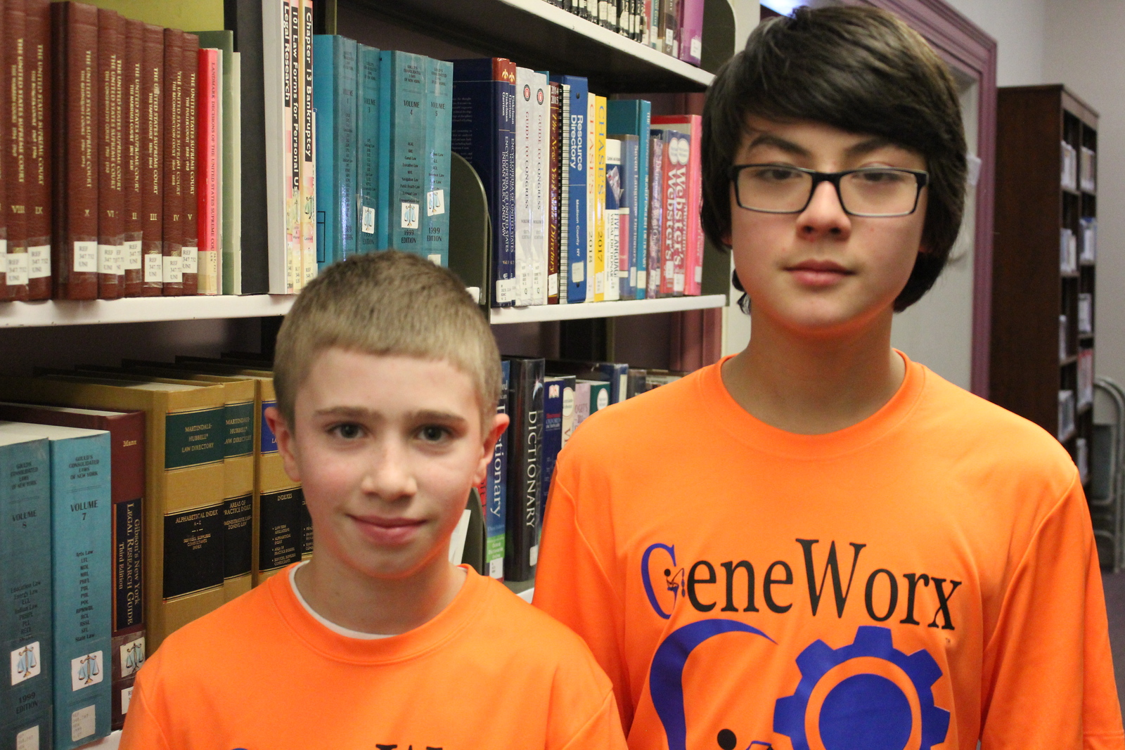 Charles Pritchard - Oneida Daily Dispatch Mason Netzband, left, and Regan Kohler at the Oneida Public Library for the Lego FIRST Robotics scrimmage on Thursday, Dec. 28, 2017.
