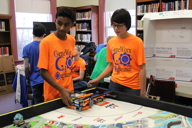 Charles Pritchard - Oneida Daily Dispatch Sraban Kodali, left, and Regan Kohler set up their team's robot for the Lego FIRST Robotics scrimmage at the Oneida Public Library on Thursday, Dec. 28, 2017.