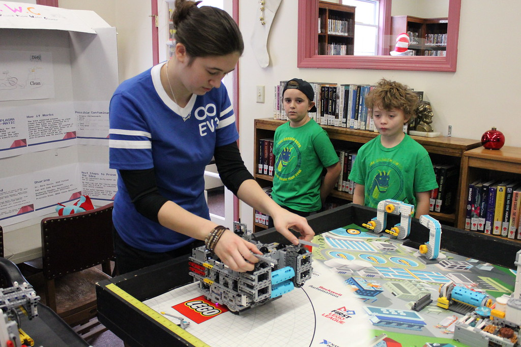 . Charles Pritchard - Oneida Daily Dispatch Corrine Bush makes some last minute adjustments before the next test for Everlasting EV3\'s robot on Thursday, Dec. 28, 2017.