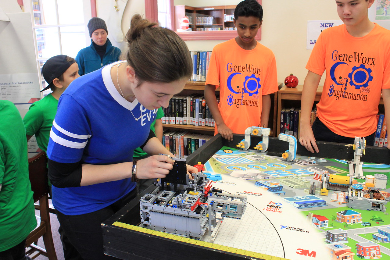 Charles Pritchard - Oneida Daily Dispatch Corrine Bush makes some last minute adjustments before the next test for Everlasting EV3's robot on Thursday, Dec. 28, 2017.