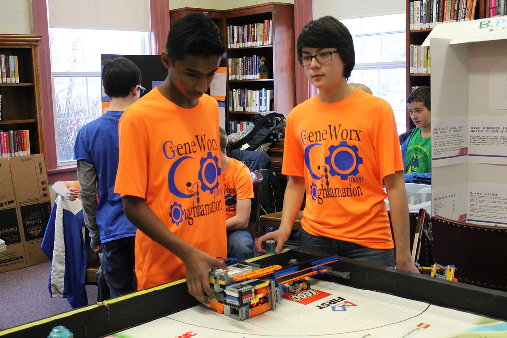. Charles Pritchard - Oneida Daily Dispatch Sraban Kodali, left, and Regan Kohler set up their team\'s robot for the Lego FIRST Robotics scrimmage at the Oneida Public Library on Thursday, Dec. 28, 2017.