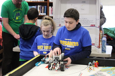 Charles Pritchard - Oneida Daily Dispatch Nathaniel Dearmore, right, and Kaylee Dearmore get ready to test their team's robot for the Lego FIRST Robotics scrimmage at the Oneida Public Library on Thursday, Dec. 28, 2017