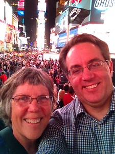 Enjoying a crowded Times Square at night.
