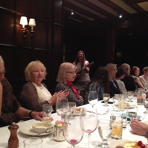 The singer presenting songs of Newfoundland at the University of Redlands luncheon.