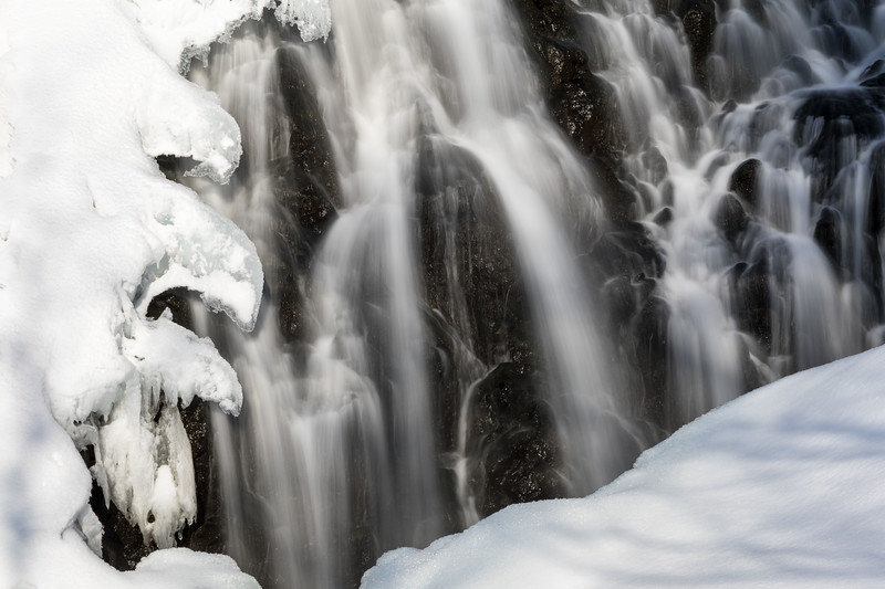 Shiretoko National Park, Hokkaido, Japan. A partially frozen roadside waterfall; a longer than usual exposure time renders the still-flowing water as silk.