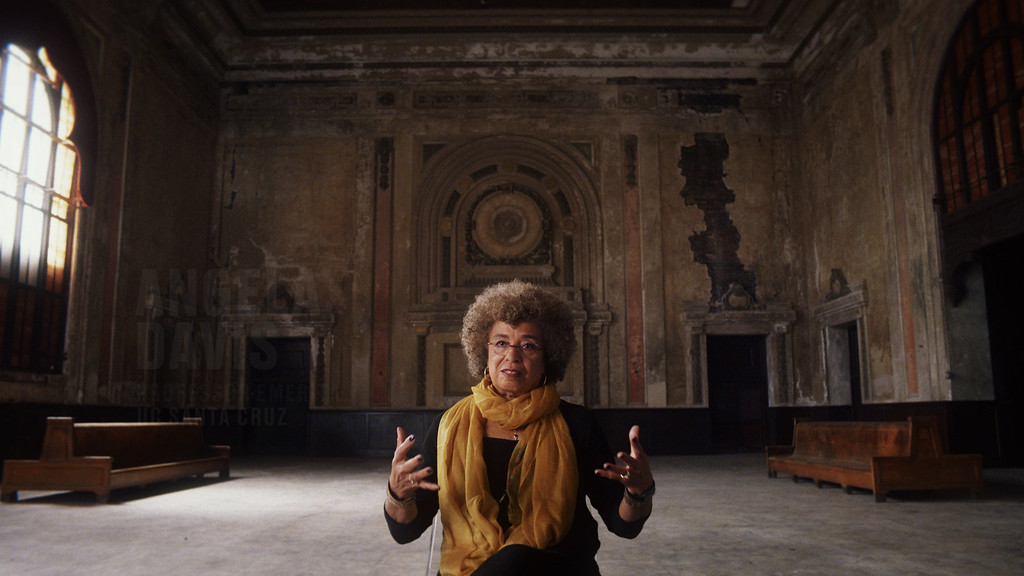 ". This image released by Netflix shows Angela Davis in a scene from the film, ""13th,\"" by Ava Duvernay. The film was nominated for an Oscar for best documentary feature on Tuesday, Jan. 24, 2017.  The 89th Academy Awards will take place on Feb. 26. (Netflix via AP)"