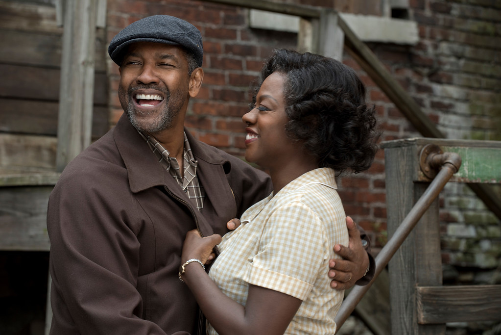 """. This image released by Paramount Pictures shows Denzel Washington, left, and Viola Davis in a scene from, \""""Fences.\"""" The film was nominated for an Oscar for best picture on Tuesday, Jan. 24, 2017.  The 89th Academy Awards will take place on Feb. 26. (David Lee/Paramount Pictures via AP)"""