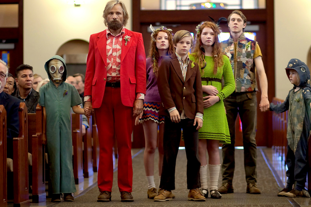 """. In this image released by Bleecker Street, Shree Crooks, standing from left, Viggo Mortensen, Samantha Isler, Nicholas Hamilton, Annalise Basso, George MacKay and Charlie Shotwell appear in a scene from, \""""Captain Fantastic.\""""  Mortensen was nominated for an Oscar for best actor in a leading role on Tuesday, Jan. 24, 2017, for his work in the film. The 89th Academy Awards will take place on Feb. 26. (Cathy Kanavy/Bleecker Street via AP)"""
