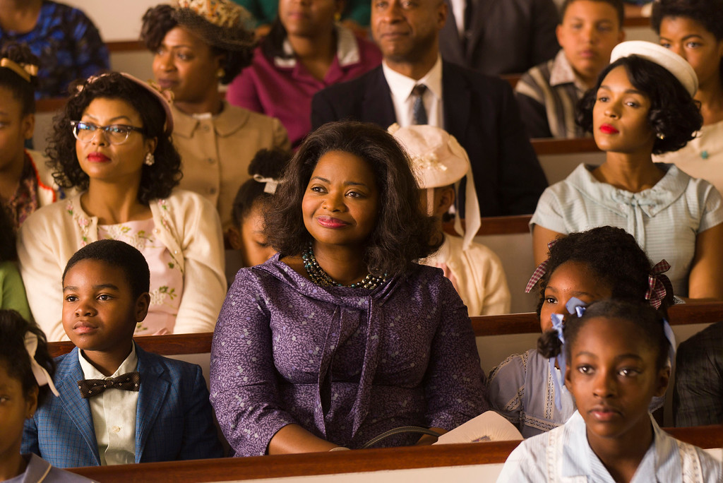 """. This image released by Twentieth Century Fox shows Taraji P. Henson, background left, Octavia Spencer, center, and Janelle Monae, background right, in a scene from \""""Hidden Figures.\"""" Spencer was nominated for an Oscar for best  supporting actress on Tuesday, Jan. 24, 2017,  for her work in the film. The 89th Academy Awards will take place on Feb. 26.  (Hopper Stone/Twentieth Century Fox via AP)"""