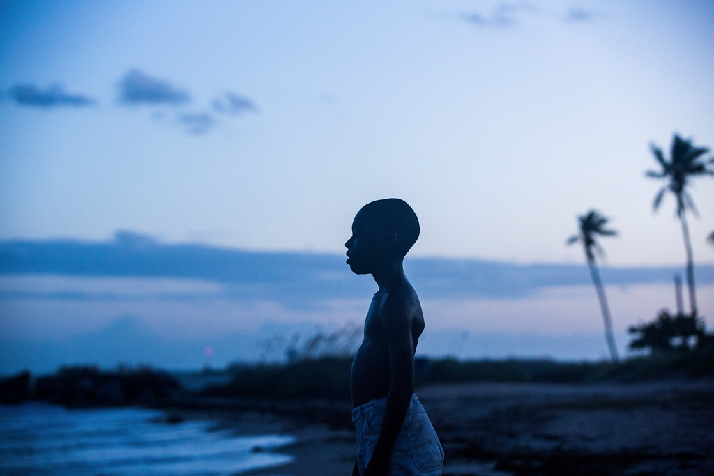 """. This image released by A24 Films shows Alex Hibbert in a scene from the film, \""""Moonlight.\"""" The film was nominated for an Oscar for best picture on Tuesday, Jan. 24, 2017.  The 89th Academy Awards will take place on Feb. 26.  (David Bornfriend/A24 via AP)"""