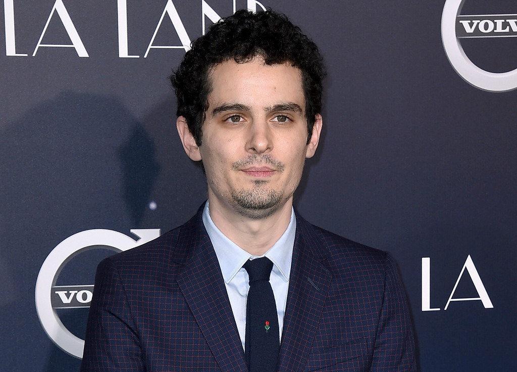 """. FILE - This Dec. 6, 2016 file photo, director Damien Chazelle arrives at the Los Angeles premiere of \""""La La Land.\"""" Chazelle was nominated for an Oscar for best directing  on Tuesday, Jan. 24, 2017, for his work on the film. The 89th Academy Awards will take place on Feb. 26.  (Photo by Jordan Strauss/Invision/AP, File)"""