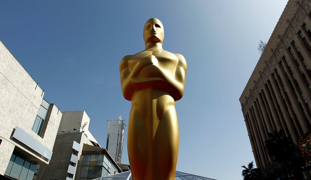 . FILE - This Feb. 26, 2012 file photo shows an Oscar statue on the red carpet before the 84th Academy Awards in Los Angeles. Nominees for the 89th Academy Awards will be announced on Tuesday, Jan. 24, 2017.. (AP Photo/Matt Sayles, File)