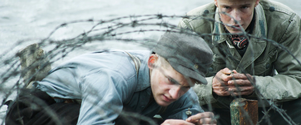 ". This image released by Sony Pictures Classics shows Oskar Bökelmann, left, and Louis Hofmann in a scene from, ""Land of Mine.\"" The film was nominated for an Oscar for best foreign language film on Tuesday, Jan. 24, 2017.  The 89th Academy Awards will take place on Feb. 26. (Sony Pictures Classics via AP)"