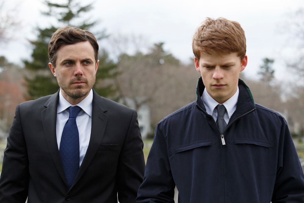 """. This image released by Roadside Attractions and Amazon Studios shows Lucas Hedges, right, and Casey Affleck in a scene from \""""Manchester By The Sea.\"""" The film was nominated for an Oscar for best picture on Tuesday, Jan. 24, 2017.  The 89th Academy Awards will take place on Feb. 26.  (Claire Folger/Roadside Attractions and Amazon Studios via AP)"""