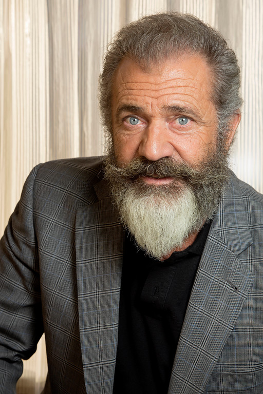 """. FILE - This Oct. 26, 2016 file photo shows director Mel Gibson posing to promote his film, \""""Hacksaw Ridge,\"""" at the Ritz Carlton in New Orleans. Gibson was nominated for an Oscar for best directing  on Tuesday, Jan. 24, 2017, for his work on the film. The 89th Academy Awards will take place on Feb. 26.  (AP Photo/Max Becherer, File)"""