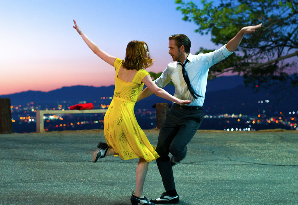 """. This image released by Lionsgate shows Ryan Gosling, right, and Emma Stone in a scene from, \""""La La Land.\"""" The film was nominated for an Oscar for best picture on Tuesday, Jan. 24, 2017.  The 89th Academy Awards will take place on Feb. 26.  (Dale Robinette/Lionsgate via AP)"""