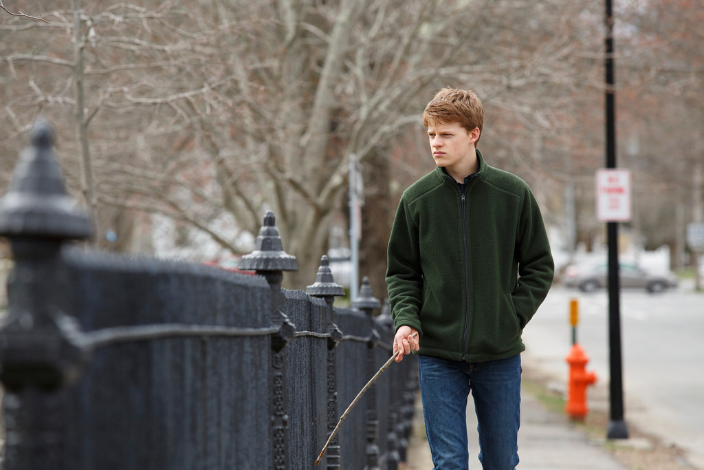 """. This image released by Roadside Attractions and Amazon Studios shows Lucas Hedges in a scene from \""""Manchester By the Sea.\"""" Hedges was nominated for an Oscar for best  supporting actor on Tuesday, Jan. 24, 2017, for his work in the film. The 89th Academy Awards will take place on Feb. 26. (Claire Folger/Roadside Attractions and Amazon Studios via AP)"""