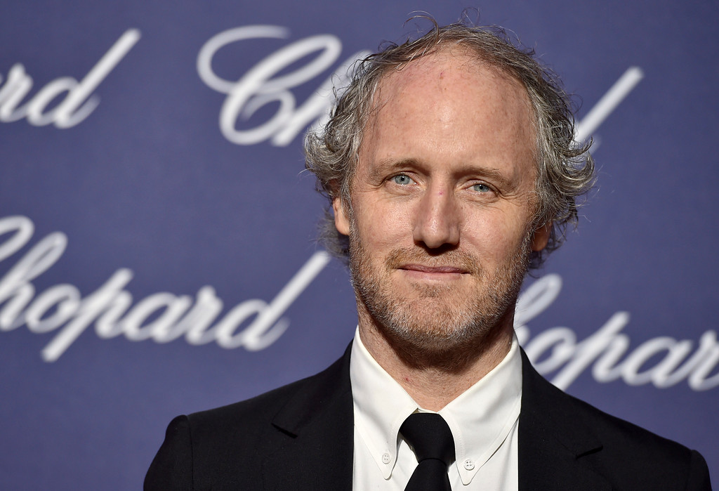 """. FILE - This Jan. 2, 2017 file photo shows Mike Mills at the 28th annual Palm Springs International Film Festival Awards Gala in Palm Springs, Calif. Mills was nominated for an Oscar for best original screenplay on Tuesday, Jan. 24, 2017, for the film, \""""20th Century Women.\"""" The 89th Academy Awards will take place on Feb. 26. (Photo by Jordan Strauss/Invision/AP, File)"""