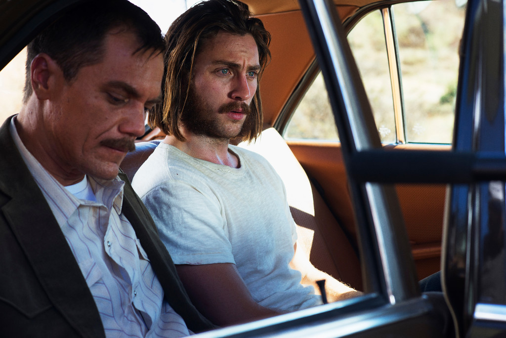 """. This image released by Focus Features shows Michael Shannon, left, and Aaron Taylor-Johnson in a scene from, \""""Nocturnal Animals.\""""  Shannon was nominated for an Oscar for best  supporting actor on Tuesday, Jan. 24, 2017, for his work in the film. The 89th Academy Awards will take place on Feb. 26. (Merrick Morton/Focus Features via AP)"""