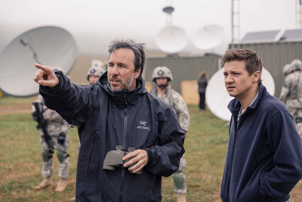 """. This image released by Paramount Pictures shows director Denis Villeneuve, left, and actor Jeremy Renner on the set of the film, \""""Arrival.\""""  Villeneuve was nominated for an Oscar for best directing  on Tuesday, Jan. 24, 2017, for his work on the film. The 89th Academy Awards will take place on Feb. 26. (Jan Thijs/Paramount Pictures via AP)"""