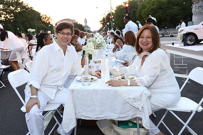 Joel Friedman and Jenny Bilfield. Photo by Tony Powell. 2017 Diner en Blanc. Pennsylvania Avenue. August 26, 2017