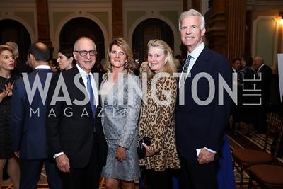 Smithsonian Sec. David Skorton and Robin Davisson, Genevieve and Fred Ryan. Photo by Tony Powell. Inaugural Monkey Ball. Kogod Courtyard. September 28, 2017