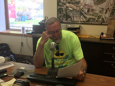 Tom Barz, IAPD Chairman reading announcements throughout the fair!