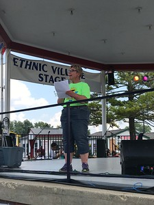 Kari Catton doing introductions at the Ethnic Village stage!