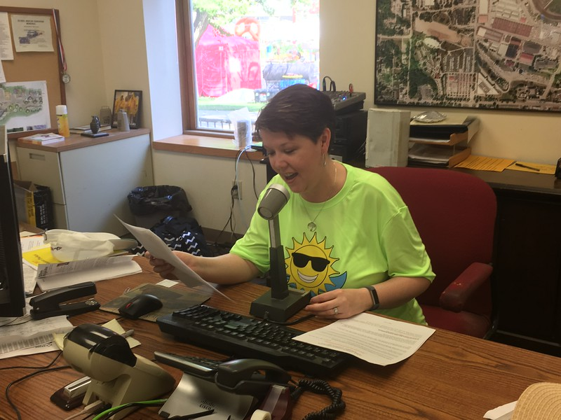Debbie Trueblood, IPRA Executive Director reading announcements throughout the fair!