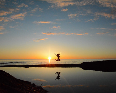 Honorary Category Runner-Up #2 - Jumping into the Sunset by Claire Haapala. Taken at Gratiot River County Park.