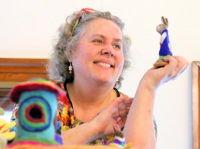 IMG_7952 margaret dwyer holds up a rabbit she made with needle felting