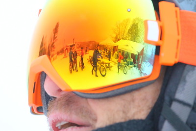 IMG_7814 riders and the warming hut reflect in goggles of rider Tim Mather, of Ct