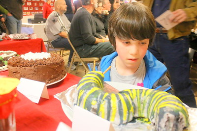 IMG_8210 alec husman,9, looks at a chocolate catipiller