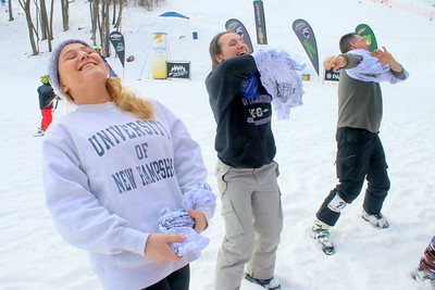 IMG_6042 frozen t-shirt contest,,madison kimberg of NJ, at left just gave up and laughed,,they had to un-knot a frozen t-shirt and put it on,,brian Labonte of bristol vt at right won