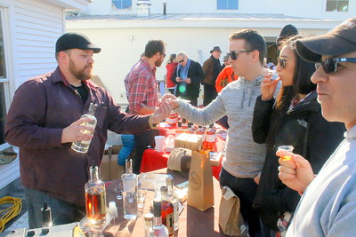 IMG_9055 jeremy herrell, of Vermont Spirits, of quechee,,hands sample to brian griffin of NYC