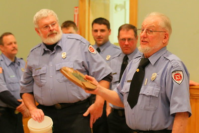 IMG_4190 chief scott mills at left presented Jack Dibble, at right, with a plaque for his years of service