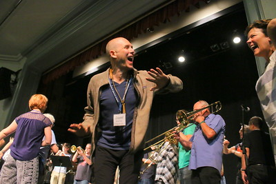IMG_2578 david muehsam at center, dancing on stage during last number, by the  Balkan Brass  Band