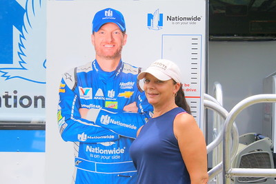 IMG_6471 bonnie sargent poses with a cutout of dale earnhardt Jr ,, near the race car simulator on tour from Earnhart's team