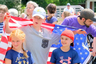 IMG_3567 keaton piconi holds flag over his sister fiona and friend andreas Tzilianos