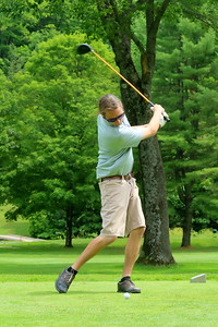 IMG_4363 devon wood takes a practice swing on the 9th
