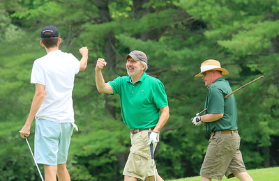 IMG_4381 Jim Phelan at center, celebrates a nice putt he made with dylan Deturk at left
