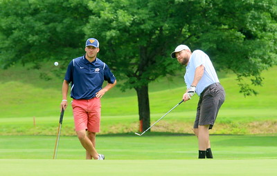 IMG_4347 hunter schmell at left, with sam griffin at right putting onto the 8th hole